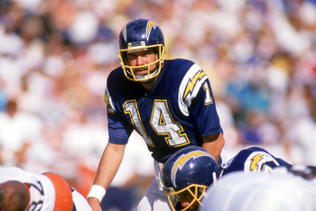 SAN DIEGO -1987: Dan Fouts #14 of the San Diego Chargers stands at the line of scrimmage during the 1987 NFL season game against the Cleveland Browns at Jack Murphy Stadium in San Diego, California. ( Photo by: Stephen Dunn/Getty Images)