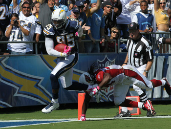 SAN DIEGO - OCTOBER 03:  Linebacker Shaun Phillips #95 of the San Diego Chargers crosses the goal line as he returns an interception for a 31 yard touchdown in the second quarter against the Arizona Cardinals at Qualcomm Stadium on October 3, 2010 in San