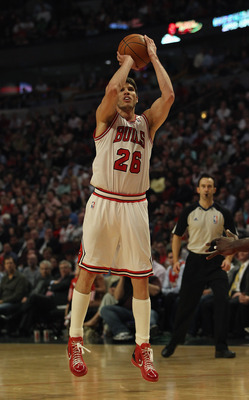 CHICAGO, IL - APRIL 13: Kyle Korver #26 of the Chicago Bulls puts up a shot on his way to 19 points against the New Jersey Nets at the United Center on April 13, 2011 in Chicago, Illinois. The Bulls defeated the Nets 97-92. NOTE TO USER: User expressly ac