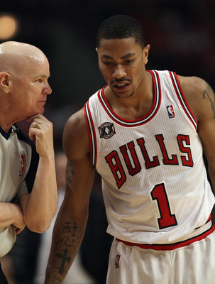 CHICAGO, IL - APRIL 16: Derrick Rose #1 of the Chicago Bulls listens to referee Joe Crawford #17 after a foul call against the Indiana Pacers in Game One of the Eastern Conference Quarterfinals in the 2011 NBA Playoffs at the United Center on April 16, 20