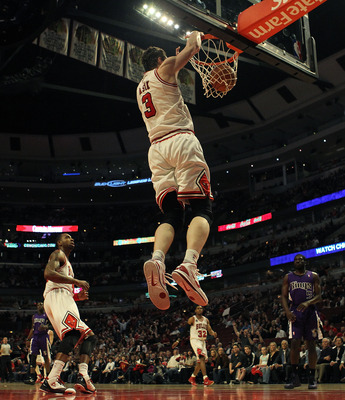 CHICAGO, IL - MARCH 21: Omer Asik #3 of the Chicago Bulls dunks the ball against the Sacramento Kings at the United Center on March 21, 2011 in Chicago, Illinois. The Bulls defeated the Kings 132-92. NOTE TO USER: User expressly acknowledges and agrees th