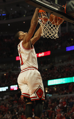 CHICAGO, IL - APRIL 16: Derrick Rose #1 of the Chicago Bulls dunks the ball against the Indiana Pacers in Game One of the Eastern Conference Quarterfinals in the 2011 NBA Playoffs at the United Center on April 16, 2011 in Chicago, Illinois. The Bulls defe