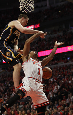 CHICAGO, IL - APRIL 16: Derrick Rose #1 of the Chicago Bulls is fouled as he moves to the basket by Tyler Hansbrough #50 of the Indiana Pacers in Game One of the Eastern Conference Quarterfinals in the 2011 NBA Playoffs at the United Center on April 16, 2
