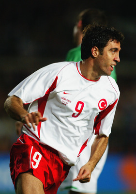 DUBLIN - SEPTEMBER 9:  Hakan Sukur of Turkey celebrates his goal during the International Friendly match between Republic of Ireland and Turkey held on September 9, 2003 at Lansdowne Road, in Dublin, Ireland. The match ended in a 2-2 draw. (Photo by Phil