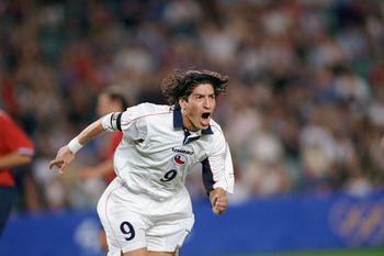 SYDNEY, AUSTRALIA - SEPTEMBER 29:  Ivan Zamorano #9 of Chile celebrates one of his two goals during the Olympic Men's Soccer Bronze Medal Game against the United States at Sydney Football Stadium in Sydney, Australia on September 29, 2000.  Chile won 2-0.