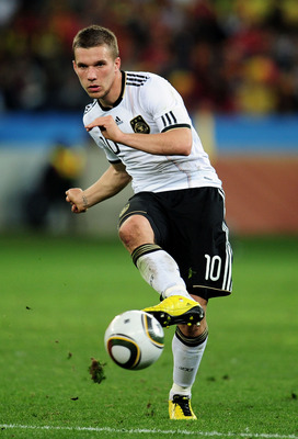 DURBAN, SOUTH AFRICA - JULY 07:  Lukas Podolski of Germany passes the ball during the 2010 FIFA World Cup South Africa Semi Final match between Germany and Spain at Durban Stadium on July 7, 2010 in Durban, South Africa.  (Photo by Clive Mason/Getty Image