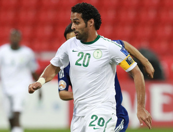 DOHA, QATAR - JANUARY 17: Yasser Al Qahtani of Saudi Arabia runs with the ball during the AFC Asian Cup Group B match between Saudi Arabia and Japan at Al-Rayyan Stadium on January 17, 2011 in Doha, Qatar.  (Photo by Robert Cianflone/Getty Images)