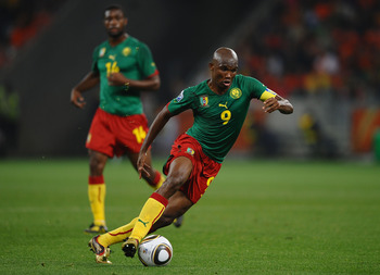 CAPE TOWN, SOUTH AFRICA - JUNE 24:  Samuel Eto'o of Cameroon runs with the ball during the 2010 FIFA World Cup South Africa Group E match between Cameroon and Netherlands at Green Point Stadium on June 24, 2010 in Cape Town, South Africa.  (Photo by Laure