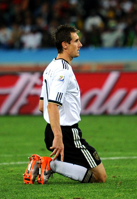 DURBAN, SOUTH AFRICA - JULY 07:  Miroslav Klose of Germany kneels on the pitch after missing a goal scoring chance during the 2010 FIFA World Cup South Africa Semi Final match between Germany and Spain at Durban Stadium on July 7, 2010 in Durban, South Af