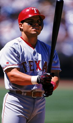 7 Jul 1999: Ivan Rodriguez of the Texas Rangers looks at his bat during the game against the Oakland Athletics at the Network Stadium in Oakland, California. The Rangers defeated the Athletics 7-4. Mandatory Credit: Jed Jacobsohn  /Allsport