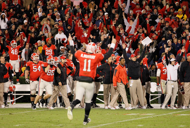ATHENS, GA - NOVEMBER 27:  The Georgia Bulldogs and quarterback Aaron Murray #11 react after a touchdown in the final minutes of play against the Georgia Tech Yellow Jackets at Sanford Stadium on November 27, 2010 in Athens, Georgia.  (Photo by Kevin C. C