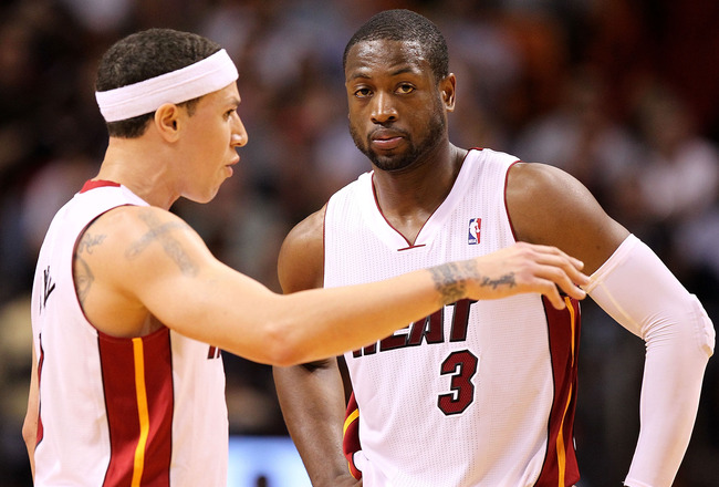 MIAMI, FL - MARCH 08: Mike Bibby #0 and Dwyane Wade #3 of the Miami Heat talk during a game against the Portland Trail Blazers at American Airlines Arena on March 8, 2011 in Miami, Florida. NOTE TO USER: User expressly acknowledges and agrees that, by dow