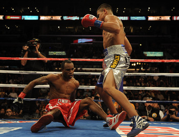 LOS ANGELES, CA - SEPTEMBER 18:  Victor Ortiz knocks down Vivian Harris during the second round in a Welterweight fight at Staples Center on September 18, 2010 in Los Angeles, California. Ortiz would win the fight in a third round knockout.  (Photo by Har