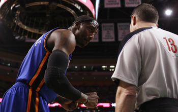 BOSTON, MA - APRIL 17:  Amare Stoudemire #1 of the New York Knicks talks with a referee in Game One of the Eastern Conference Quarterfinals in the 2011 NBA Playoffs on April 17, 2011 at the TD Garden in Boston, Massachusetts. NOTE TO USER: User expressly