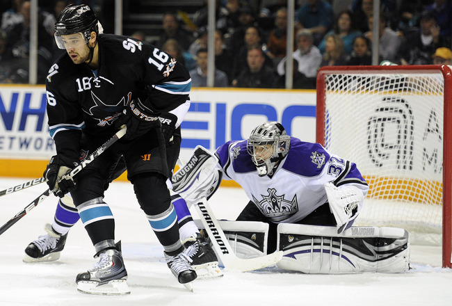 SAN JOSE, CA - APRIL 16: Jonathan Quick #32 of the Los Angeles Kings tries to keep his eye on the puck behind Devin Setoguchi #16 of the San Jose Sharks in Game Two of the Western Conference Quarterfinals during the 2011 NHL Stanley Cup Playoffs at the HP