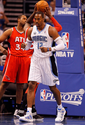 ORLANDO, FL - APRIL 16:  Dwight Howard #12 of the Orlando Magic is pumped up after a shot against the Atlanta Hawks during Game One of the Eastern Conference Quarterfinals of the 2011 NBA Playoffs on April 16, 2011 at the Amway Arena in Orlando, Florida.