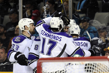SAN JOSE, CA - APRIL 16: Kyle Clifford #13 of the Los Angeles Kings scores a goal and celebrates with teammates, Willie Mitchell #33, Wayne Simmonds #17, Drew Doughty #8 and Brad Richardson #15 during a game against the San Jose Sharks in Game Two of the