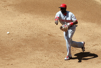 PHOENIX, AZ - APRIL 10:  Iniflder Brandon Phillips #4 of the Cincinnati Reds fields a ground ball out against the Arizona Diamondbacks during the Major League Baseball game at Chase Field on April 10, 2011 in Phoenix, Arizona.  The Diamondbacks defeated t