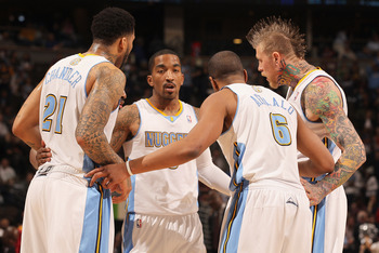 DENVER, CO - FEBRUARY 28:  (L-R) Wilson Chandler #21, Raymond Felton #20 (hidden), J.R. Smith #5, Arron Afflalo #6 and Chris Andersen #11 of the Denver Nuggets huddle up against the Atlanta Hawks during NBA action at the Pepsi Center on February 28, 2011