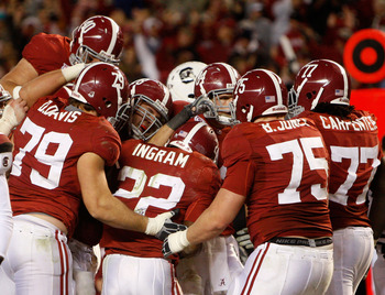 TUSCALOOSA - OCTOBER 17:  Alabama Crimson Tide teammates, including offensive lineman Drew Davis, offensive lineman Barrett Jones #75 and offensive lineman James Carpenter #77, swarm running back Mark Ingram #22 after his fourth quarter, game clinching to