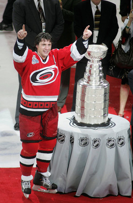 RALEIGH, NC - JUNE 19:  Rod Brind'Amour #17 of the Carolina Hurricanes gives the thumbs up while standing next to the Stanley Cup after the Hurricanes defeated the Edmonton Oilers in game seven of the 2006 NHL Stanley Cup Finals on June 19, 2006 at the RB