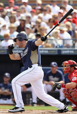 PEORIA, AZ - MARCH 15:  Ryan Ludwick #47 of the San Diego Padres hits a single against the Los Angeles Angels of Anaheim during the first inning of the spring training game at Peoria Stadium on March 15, 2011 in Peoria, Arizona.  (Photo by Christian Peter