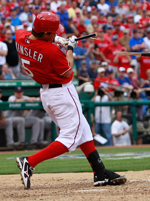 ARLINGTON, TX - APRIL 01:  Ian Kinsler #5 of the Texas Rangers shatters his bat on a pitch against the Boston Red Sox on Opening Day at Rangers Ballpark in Arlington on April 1, 2011 in Arlington, Texas.  (Photo by Tom Pennington/Getty Images)