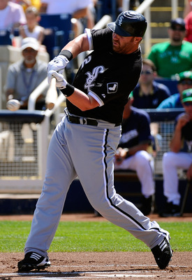 PHOENIX, AZ - MARCH 17:  Adam Dunn #32 of the Chicago White Sox at bat against the Milwaukee Brewers during the spring training game at Maryvale Baseball Park on March 17, 2011 in Phoenix, Arizona.  (Photo by Kevork Djansezian/Getty Images)