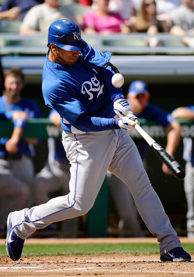 MESA, AZ - MARCH 09:  Mike Aviles #13 of the Kansas City Royals at bat against the Chicago Cubs during the spring training baseball game at HoHoKam Stadium on March 9, 2011 in Mesa, Arizona.  (Photo by Kevork Djansezian/Getty Images)