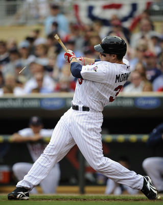 MINNEAPOLIS, MN - APRIL 10: Justin Morneau #33 of the Minnesota Twins breaks his bat against the Oakland Athletics during the first inning a game on April 10, 2011 at Target Field in Minneapolis, Minnesota. (Photo by Hannah Foslien/Getty Images)