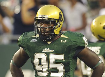 TAMPA, FL - SEPTEMBER 12: Defensive end George Selvie #95 of the University of South Florida Bulls watches play against the Kansas University Jayhawks at Raymond James Stadium on September 12, 2008 in Tampa, Florida.  (Photo by Al Messerschmidt/Getty Imag