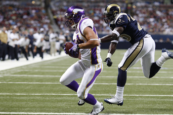 ST. LOUIS, MO - AUGUST 14: Logan Payne #84 of the Minnesota Vikings catches a touchdown pass against Marquis Johnson #25 of the St. Louis Rams during the preseason game at Edward Jones Dome on August 14, 2010 in St. Louis, Missouri. (Photo by Joe Robbins/