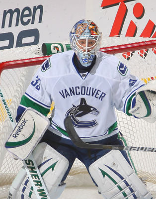 BUFFALO, NY - NOVEMBER 15:  Corey Schneider #35 of the Vancouver Canucks stands in goal against the Buffalo Sabres  at HSBC Arena on November 15, 2010 in Buffalo, New York. Buffalo won 4-3 in overtime.  (Photo by Rick Stewart/Getty Images)