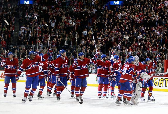 MONTREAL, CANADA - APRIL 5:  Members of the Montreal Canadiens wave to fans after defeating the Chicago Blackhawks and clinching a playoff position during the NHL game at the Bell Centre on April 5, 2011 in Montreal, Quebec, Canada.  The Canadiens defeate