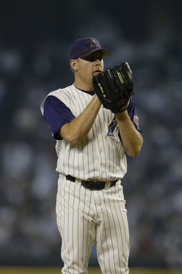 PHOENIX, AZ - OCTOBER 3:  Pitcher Curt Schilling of the Arizona Diamondbacks prepares to pitch the ball against the St. Louis Cardinals during game two of the National League Divisional Series at Bank One Ballpark on October 3, 2002 in Phoenix, Arizona.