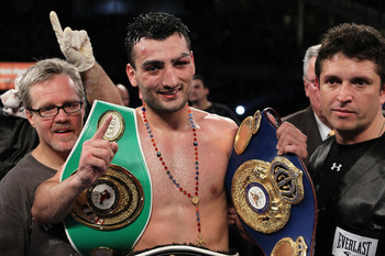 NEW YORK - JUNE 05:  Vanes Martirosyan (C) celebrates defeating Joe Green with his trainer Freddie Roach (L) after the NABF & NABO super welterweight fight on June 5, 2010 at Yankee Stadium in the Bronx borough of New York City. Matirosyan wins by unanimo