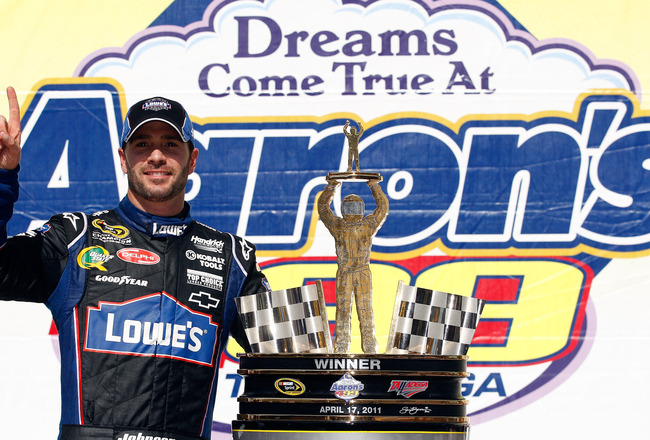 TALLADEGA, AL - APRIL 17:  Jimmie Johnson, driver of the #48 Lowe's Chevrolet, poses in Victory Lane after winning the NASCAR Sprint Cup Series Aaron's 499 at Talladega Superspeedway on April 17, 2011 in Talladega, Alabama.  (Photo by Chris Graythen/Getty