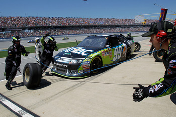 TALLADEGA, AL - APRIL 17:  Carl Edwards, driver of the #99 Aflac Ford, comes in for a pit stop during the NASCAR Sprint Cup Series Aaron's 499 at Talladega Superspeedway on April 17, 2011 in Talladega, Alabama.  (Photo by Todd Warshaw/Getty Images for NAS