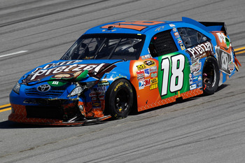 TALLADEGA, AL - APRIL 17:  Kyle Busch drives the wrecked #18 M&M's Pretzel Toyota after an incident in the NASCAR Sprint Cup Series Aaron's 499 at Talladega Superspeedway on April 17, 2011 in Talladega, Alabama.  (Photo by Jeff Zelevansky/Getty Images for