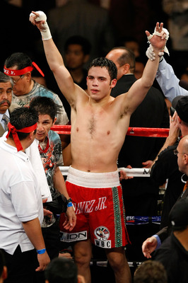LAS VEGAS - NOVEMBER 14:  Julio Cesar Chavez Jr. of Mexico celebrates after defeating Troy Rowland by unanimous decision during their middleweight fight at the MGM Grand Garden Arena on November 14, 2009 in Las Vegas, Nevada.  (Photo by Ethan Miller/Getty