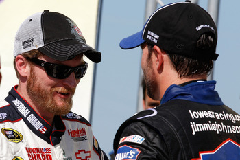 TALLADEGA, AL - APRIL 17:  Jimmie Johnson (R), driver of the #48 Lowe's Chevrolet, talks with teammates Dale Earnhardt Jr. (L), driver of the #88 National Guard/Amp Energy Chevrolet, in Victory Lane after winning the NASCAR Sprint Cup Series Aaron's 499 a