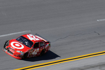 TALLADEGA, AL - APRIL 17:  Juan Pablo Montoya, driver of the #42 Target Chevrolet, drives with damage after a crash during the NASCAR Sprint Cup Series Aaron's 499 at Talladega Superspeedway on April 17, 2011 in Talladega, Alabama.  (Photo by John Harrels
