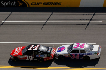TALLADEGA, AL - APRIL 17:  Tony Stewart, driver of the #14 Office Depot/Mobil 1 Chevrolet, leads David Gilliland, driver of the #34 Taco Bell Ford, during the NASCAR Sprint Cup Series Aaron's 499 at Talladega Superspeedway on April 17, 2011 in Talladega,