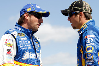 TALLADEGA, AL - APRIL 16:  David Reutimann (L), driver of the #00 Aaron's Coloring Contest Toyota, talks with Martin Truex Jr. (R), driver of the #56 NAPA Auto Parts Toyota, on the grid during qualifying for the NASCAR Sprint Cup Series Aaron's 499 at Tal