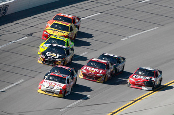 TALLADEGA, AL - APRIL 17:  Dave Blaney, driver of the #26 Golden Corral Chevrolet, leads a pack of cars during the NASCAR Sprint Cup Series Aaron's 499 at Talladega Superspeedway on April 17, 2011 in Talladega, Alabama.  (Photo by Jerry Markland/Getty Ima