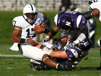 EVANSTON, IL - OCTOBER 31: Daryll Clark #17 of the Penn State Nittany Lions is tackled by Nate Williams #57 and Quentin Davie #41 of the Northwestern Wildcats at Ryan Field on October 31, 2009 in Evanston, Illinois. (Photo by Jonathan Daniel/Getty Images)