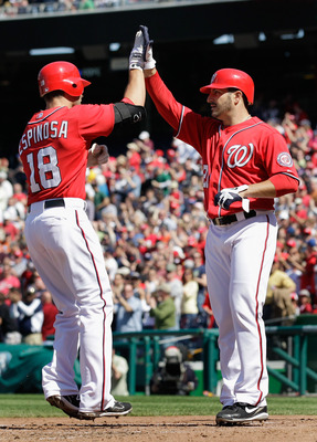 WASHINGTON, DC - APRIL 17:  Danny Espinosa #18 of the Washington Nationals celebrates with pitcher Jason Marquis #21 after Espinosa hit a three run home run during the fifth inning against the Milwaukee Brewers during the first game of a doubleheader at N