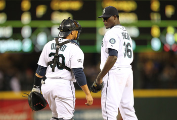 SEATTLE, WA - APRIL 12:  Starting pitcher Michael Pineda #36 of the Seattle Mariners talks with catcher Miguel Olivo #30 during the game against the Toronto Blue Jays at Safeco Field on April 12, 2011 in Seattle, Washington. (Photo by Otto Greule Jr/Getty