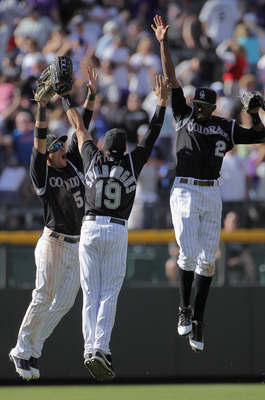 DENVER, CO - APRIL 17:  Outfielders Carlos Gonzalez #5, Ryan Spilborghs #19 and Dexter Fowler #24 of the Colorado Rockies celebrate after the Rockies 9-5 win over the Chicago Cubs at Coors Field on April 17, 2011 in Denver, Colorado.  (Photo by Doug Pensi