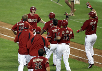 PHOENIX, AZ - APRIL 17:  Stephen Drew #6 of the Arizona Diamondbacks celebrates with teammates after his game winning RBI single during the twelfth inning of the Major League Baseball game against the San Francisco Giants at Chase Field on April 17, 2011